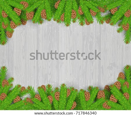 Fir tree branches with cones top and down on white wood background #717846340