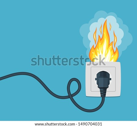 Fire wiring. Socket and plug on fire from overload. Electrical safety concept. Short circuit electrical circuit. Broken electrical connection