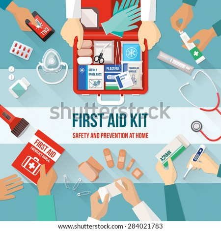 First aid kit with medications and emergency equipment and medical team hands