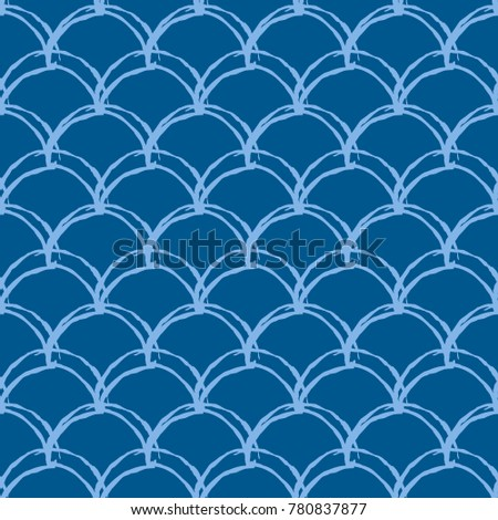 Stock Photo Fish scale seamless pattern. Reptile, dragon skin texture. Tillable background for your fabric, textile design, wrapping paper, swimwear or wallpaper. Blue mermaid tail with fish scale underwater.