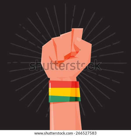 fist hand held high with rasta