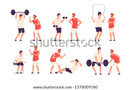Fitness trainer. Male personal coach helps bodybuilder
