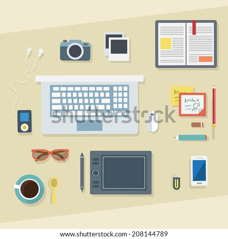 Flat design vector illustration. Designer's business workplace with cup of coffee, digital tablet, smartphone, papers, photo, book, pen and various office objects on table.