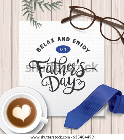 Flat lay style father`s day greeting card with cup of coffee, necktie and glasses on wooden table.