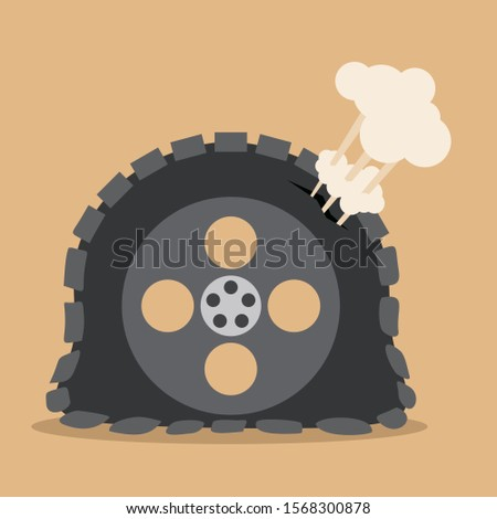 flat tire on brown background