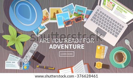 Flat vector web banner on the theme of travel , vacation, adventure. Preparing for your journey. Outfit of modern traveler. Objects on wooden background. Top view. Are you ready for Adventure #1