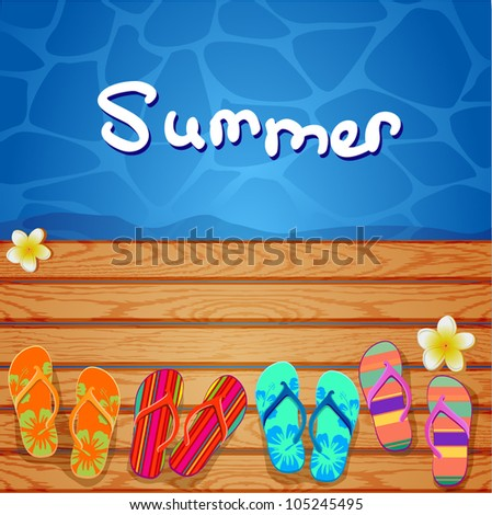 flip flops on the wood background