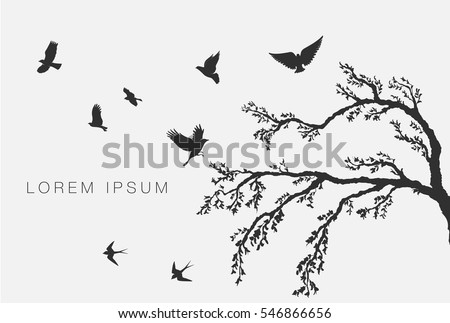 flock of flying birds on tree