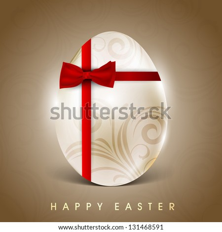 Floral decorated egg wrapped with red ribbon on brown background for Happy Easter.