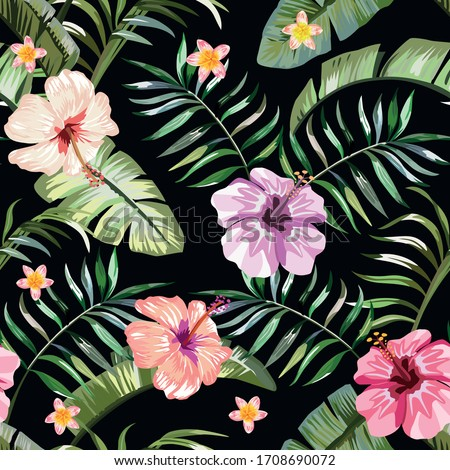 Floral exotic tropical seamless pattern tropic hawaiian wallpaper. Vivid hibiscus and plumeria (frangipani) flowers and green palm banana leaves on a black background. Beach backdrop repeating design.