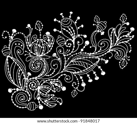 floral pattern is embroidered with white thread on black background