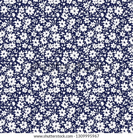 Floral pattern. Pretty flowers on dark blue background. Printing with small white flowers. Ditsy print. Seamless vector texture. Spring bouquet.