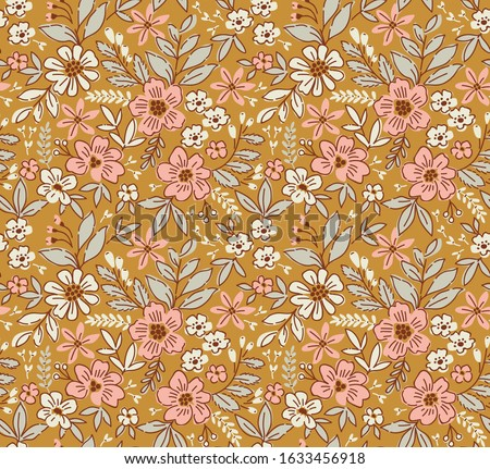 Floral pattern. Pretty flowers on gold  background. Printing with small  flowers. Ditsy print. Seamless vector texture. Spring bouquet.