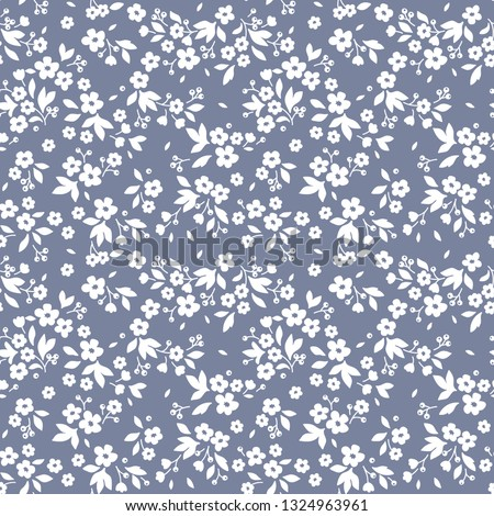 Floral pattern. Pretty flowers on  gray blue background. Printing with small white flowers. Ditsy print. Seamless vector texture. Spring bouquet.