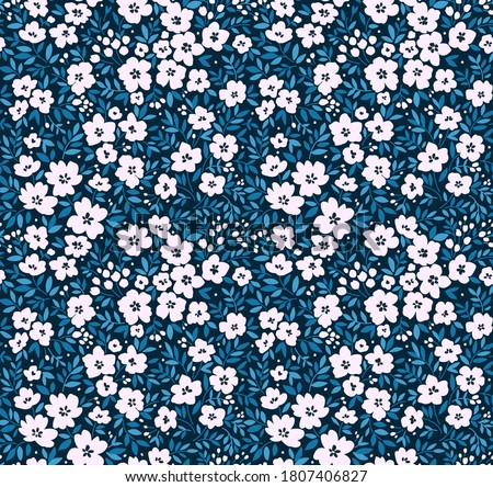 Floral pattern. Pretty flowers on navy blue background. Printing with small white flowers. Ditsy print. Seamless vector texture. Spring bouquet.