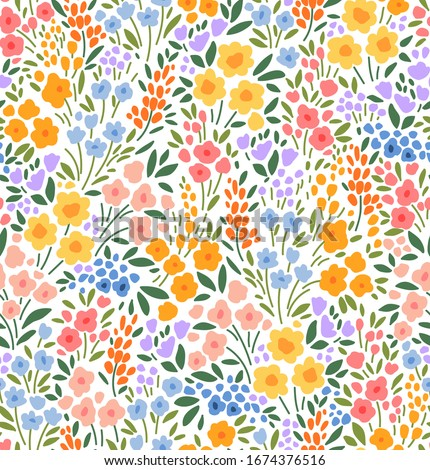 Floral pattern. Pretty flowers on white background. Printing with small colorful flowers. Ditsy print. Seamless vector texture. Spring bouquet. Stock photo ©