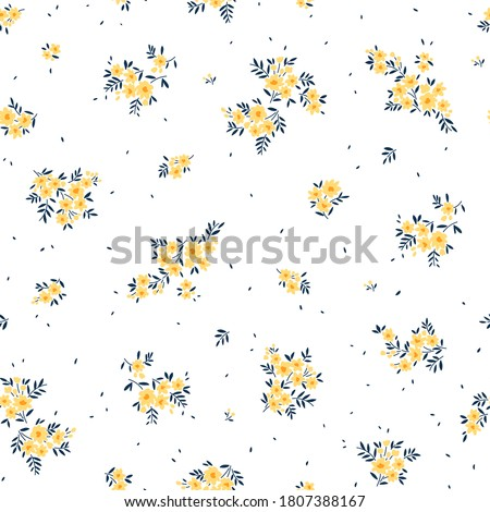 Floral pattern. Pretty flowers on white background. Printing with small yellow flowers. Ditsy print. Seamless vector texture. Spring bouquet.