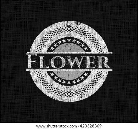 Flower chalkboard emblem on black board