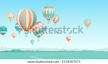 flying hot air balloons in sky