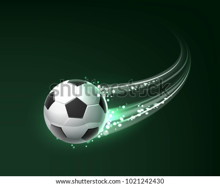 Flying soccer ball with shine motion blur isolated on dark background