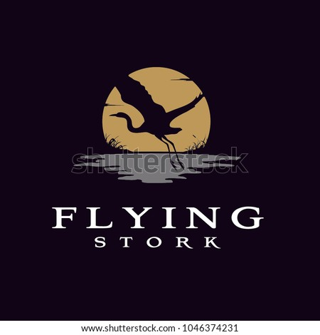 flying stork heron bird on