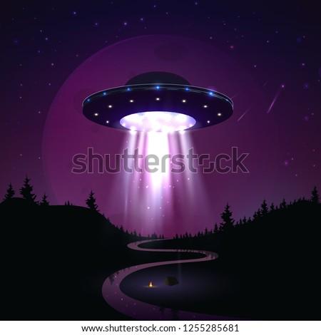 flying ufo over night landscape