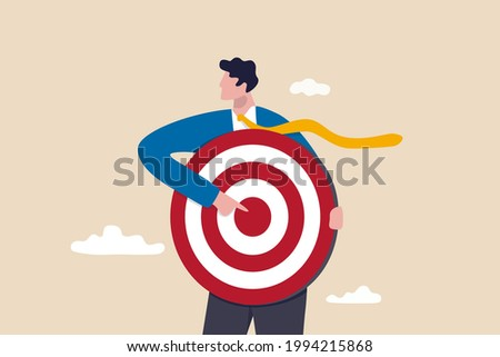 Focus on business target, setting goal for motivation, target audience for advertising or purpose for career development concept, businessman holding archer target or dashboard pointing at bullseye.