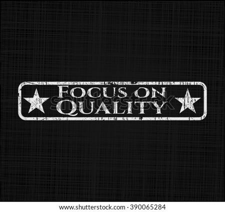 Focus on Quality chalkboard emblem written on a blackboard