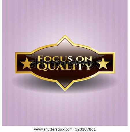 Focus on Quality gold badge or emblem