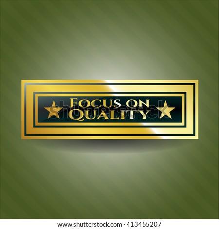 Focus on Quality gold emblem or badge