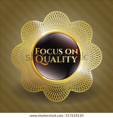 Focus on Quality gold shiny badge