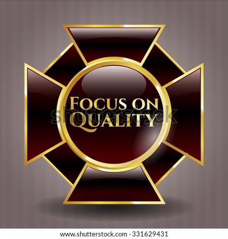 Focus on Quality golden emblem or badge