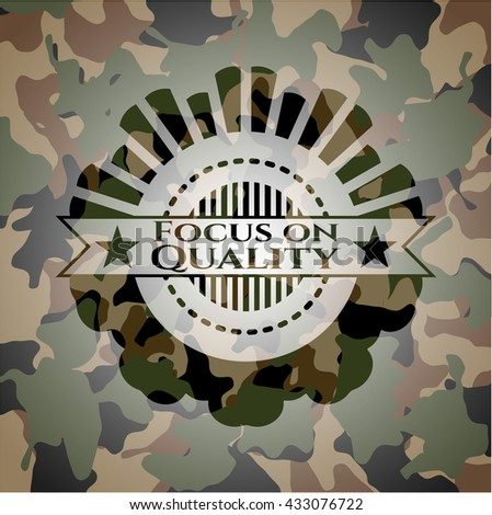 Focus on Quality written on a camo texture