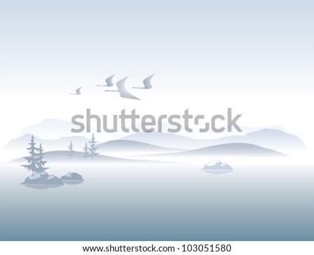 foggy mountains on the lake