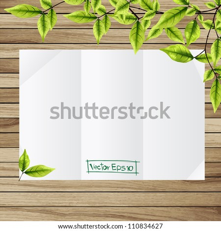 folded paper at wooden background with green leaves decoration, vector illustration