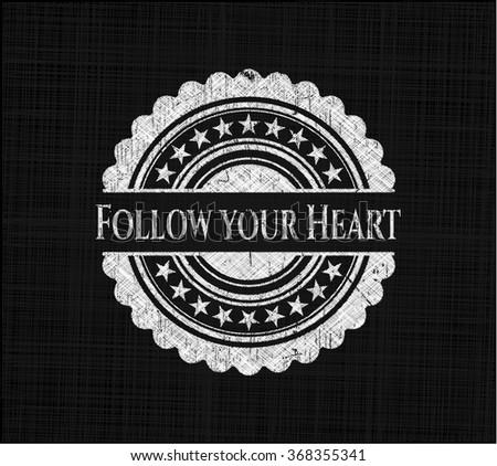 Follow your Heart chalkboard emblem written on a blackboard