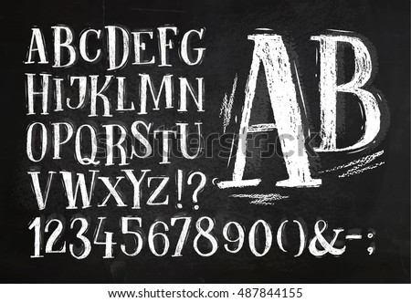 Font pencil vintage alphabet drawing with chalk on chalkboard background.