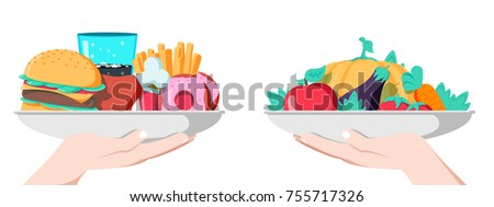 Food choice concept. Two hands with healthy and fresh vegetables and junk unhealthy fast food. Concept diet - plate with fruits and organic versus fast food plate with burger, french fries and donuts