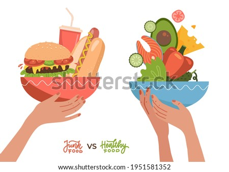 Food choice concept. Two hands with healthy and fresh vegetables, fish, cheees and junk unhealthy fast food. Concept diet - plate with organic meal versus fast food plate with burger, hotdog and soda