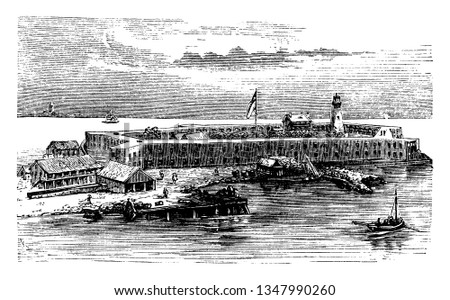 Fort Jefferson which is located today in what is Dry Tortugas National Park, vintage line drawing or engraving illustration.