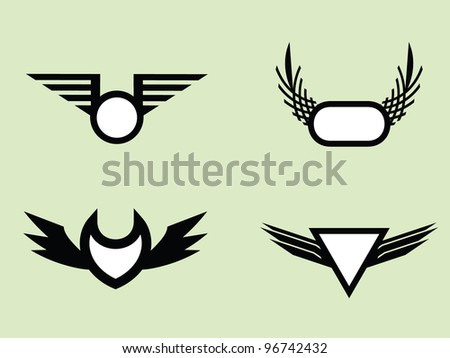 Four Monogram Wing Badges.