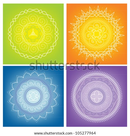 Four white mandalas on the colors background