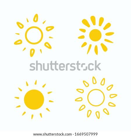Four yellow suns. Set of painted yellow suns. Vector solar symbols set.