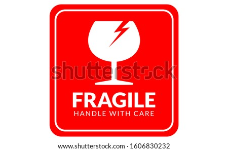 Fragile label handle with care icon can used for carton fragile mark label, box signs, shipping mark, package markings, stamp fragile label. FRAGILE set contain icon and red box with white background.
