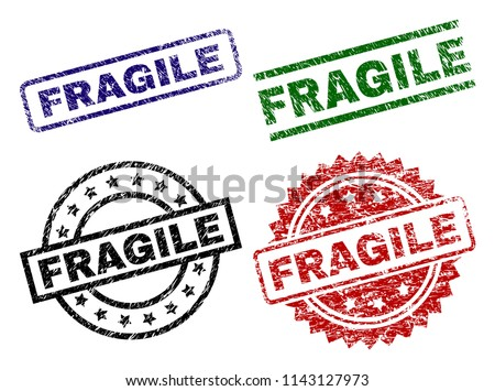 FRAGILE seal stamps with damaged style. Black, green,red,blue vector rubber prints of FRAGILE text with unclean style. Rubber seals with circle, rectangle, rosette shapes.