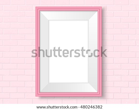 frame on brick wall pink