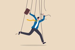 Freedom for work and decision making, authority to work independently, stop micromanagement, or people manipulation concept, businessman marionette, puppeteer use scissors to cut controlled strings.