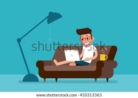 Freelancer working at home with laptop computer on cozy sofa.