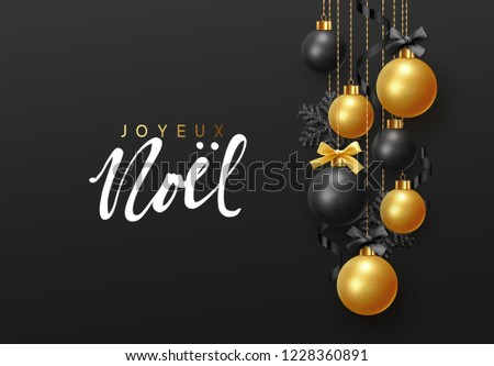 French text Joyeux Noel. (Translation Merry Christmas and Happy New Year.) Background hanging gold and black balls with ribbon and bow. Xmas greeting card with decorative bauble