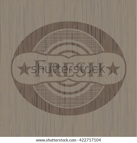 Fresh badge with wooden background